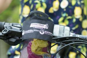 Elk deelnemend gezin krijgt een herbruikbaar fietsafvalzakje.